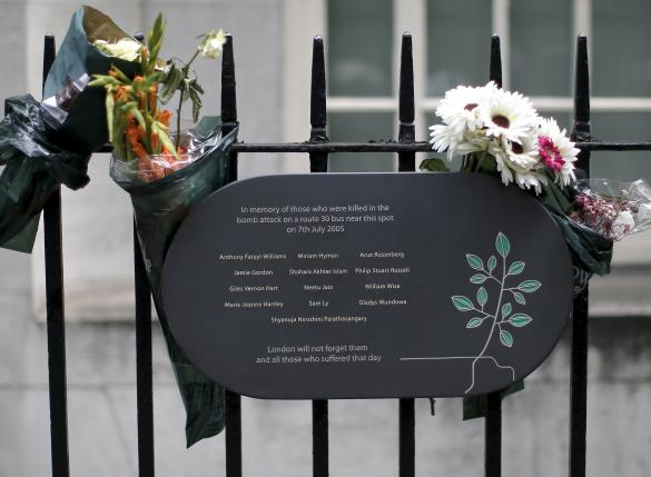 A memorial plaque is attached to railings in Tavistock Square, in memory of those who lost their lives on a number 30 double-decker bus during the 7/7 attack in 2005, in London, July 6, 2015.  REUTERS/Peter Nicholls